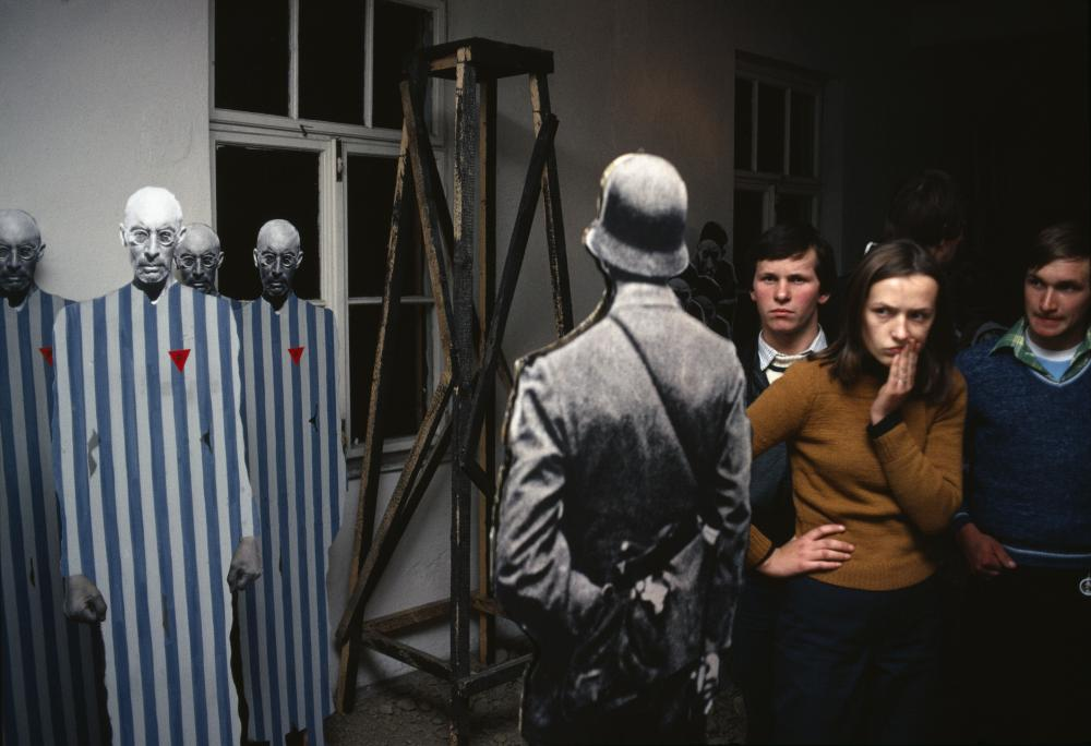 This photo was taken at the Auschwitz-Birkenau Museum in 1981 by photojournalist Bruno Barbey.