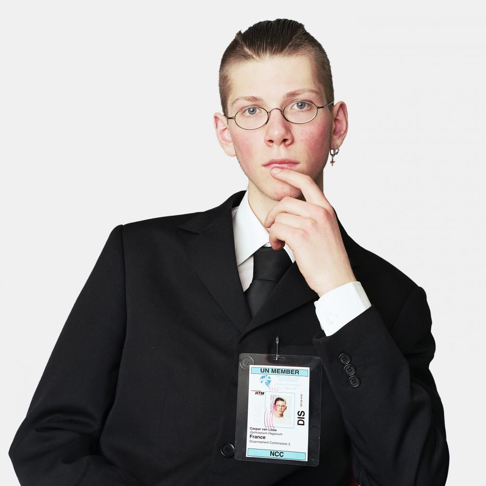 The portrait of Caspar above was taken by Dutch photographer, Alex Ten Napel. It is part of the «Young Diplomats» series, photographed at the Hague Model United Nations in which young students congregate in a copy of a UN General Assembly