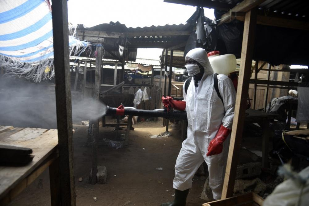 An informal market in the Anyama district of Abidjan, Ivory Coast, is sanitized on 25 April 2020, against the Coronavirus COVID-19.  By Sia Kambou / AFP