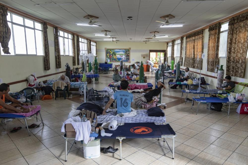 General view of a ward, on 9 May 2020, where COVID-19 patients breathe with the assistance of oxygen masks, at the regional hospital in Iquitos, the largest city in the Peruvian Amazon. By Ginebra PENA / AFP