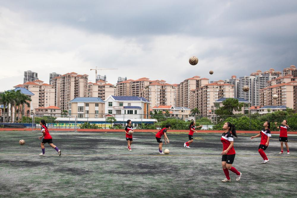 "The ""Dream of Dragons"", a girls and disabled (deaf) football team photographed by Chris Steele-Perkins in 2016 at Zhanjiang, China"