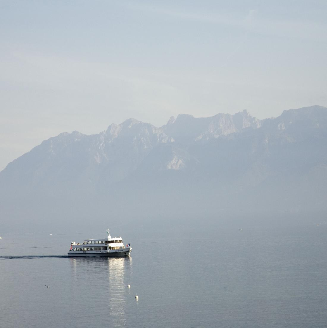 "From 28 to 29 June, UNECE will organize a ""Virtual Workshop on designing legal frameworks for transboundary water cooperation"" to assist countries and relevant stakeholders.  Magnum partner Peter Marlow took this picture of a boat sailing between Switzerland and France on the Leman Lake seen from Lausanne, Switzerland, in 2006."