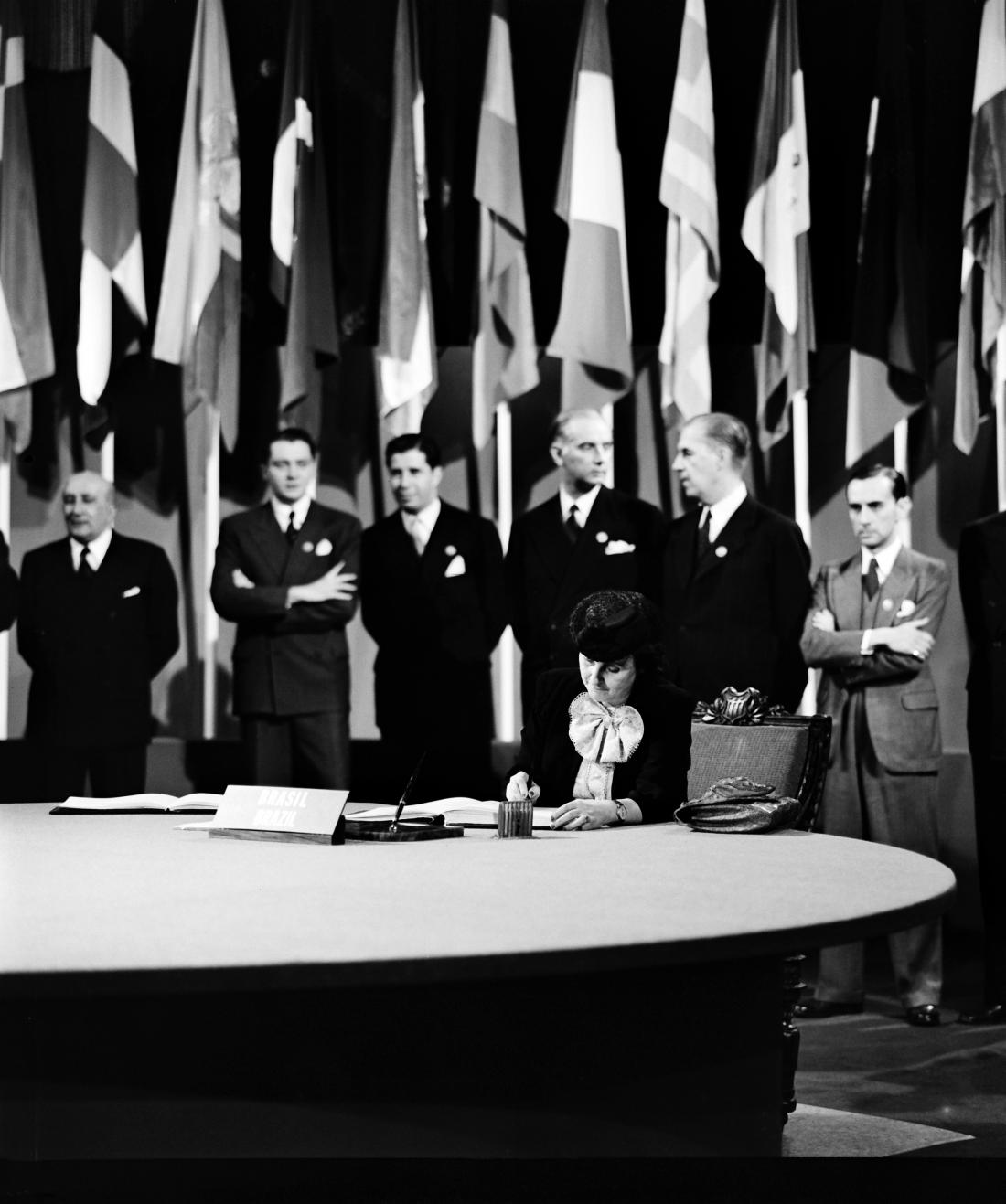 Dr. Bertha Lutz, National Museum, President of the Confederated Association of Women of Brazil, former Congresswoman and member of the delegation from Brazil, signing the UN Charter at a ceremony held at the Veterans' War Memorial Building on 26 June 1945.
