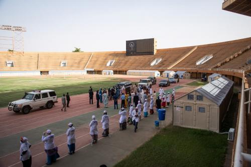 Inauguration of a medical centre, donated by the UN Refugee Agency (UNHCR) to isolate and treat patients tested with COVID-19, at the Seyni Kountche stadium in Niamey, Niger, on 17 April 2020. By photographer Nicolas Réméné / AFP.