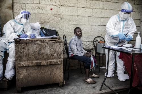 A kid waits for his samples to be collected by a health worker during the COVID-19 coronavirus mass testing exercise inducted by Kenya's Ministry of Health in the Kawangware slums of Nairobi on 1 May 2020. By Luis Tato / AFP